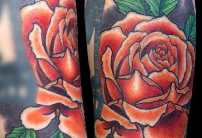 orange rose tattoo by Jake B