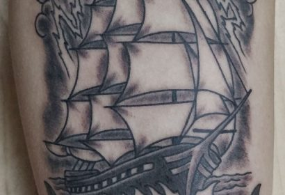 black and grey traditional style clipper ship tattoo