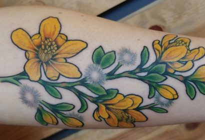 yellow flowers creosote tattoo featured image
