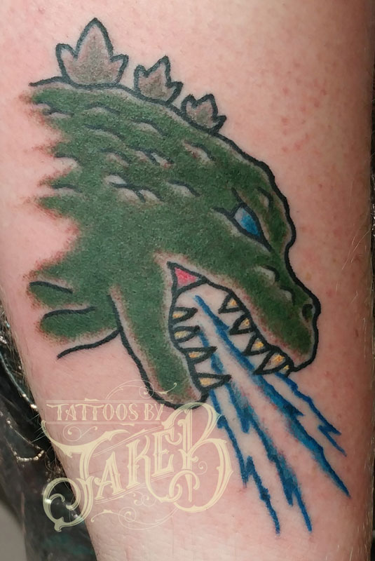 Traditional style godzilla tattoo by Jake B