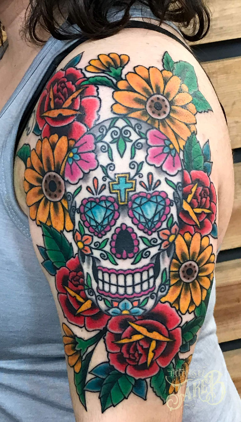 sugar skull and flowers tattoo