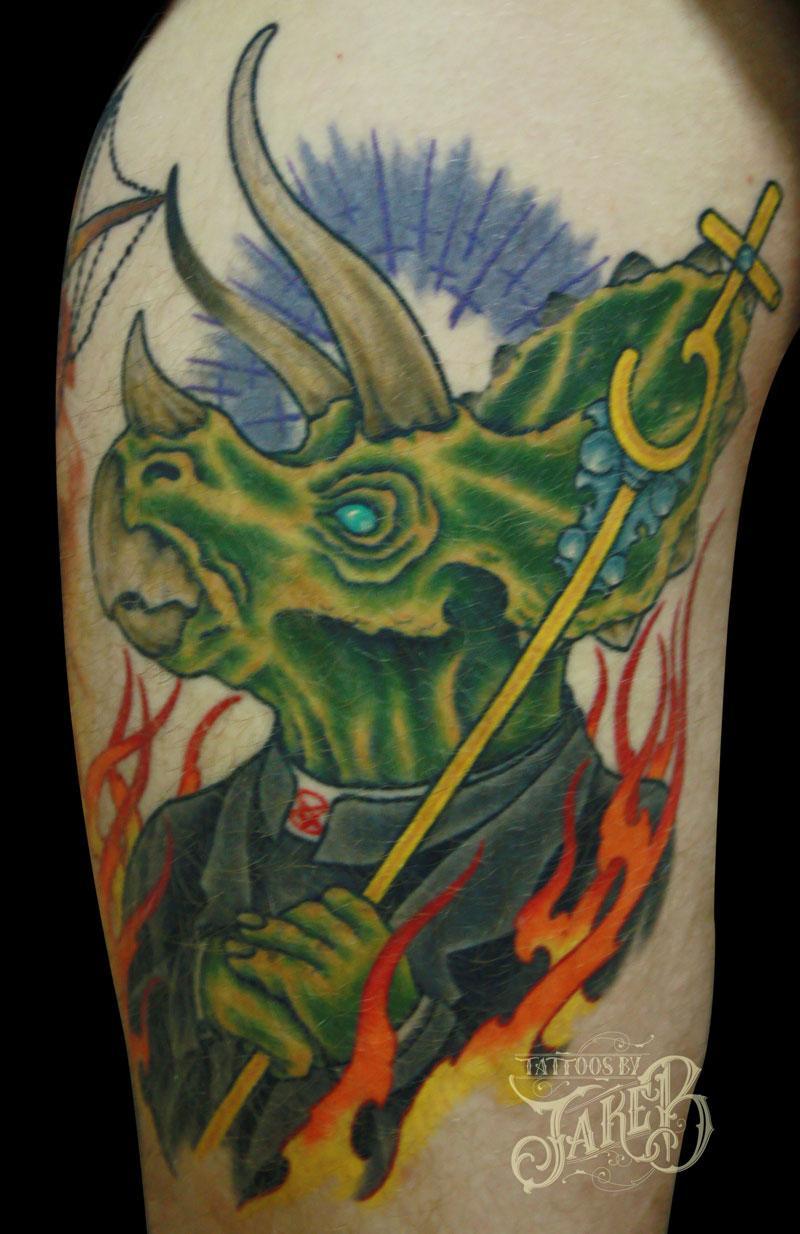 nerdy dinosaur priest triceratops tattoo