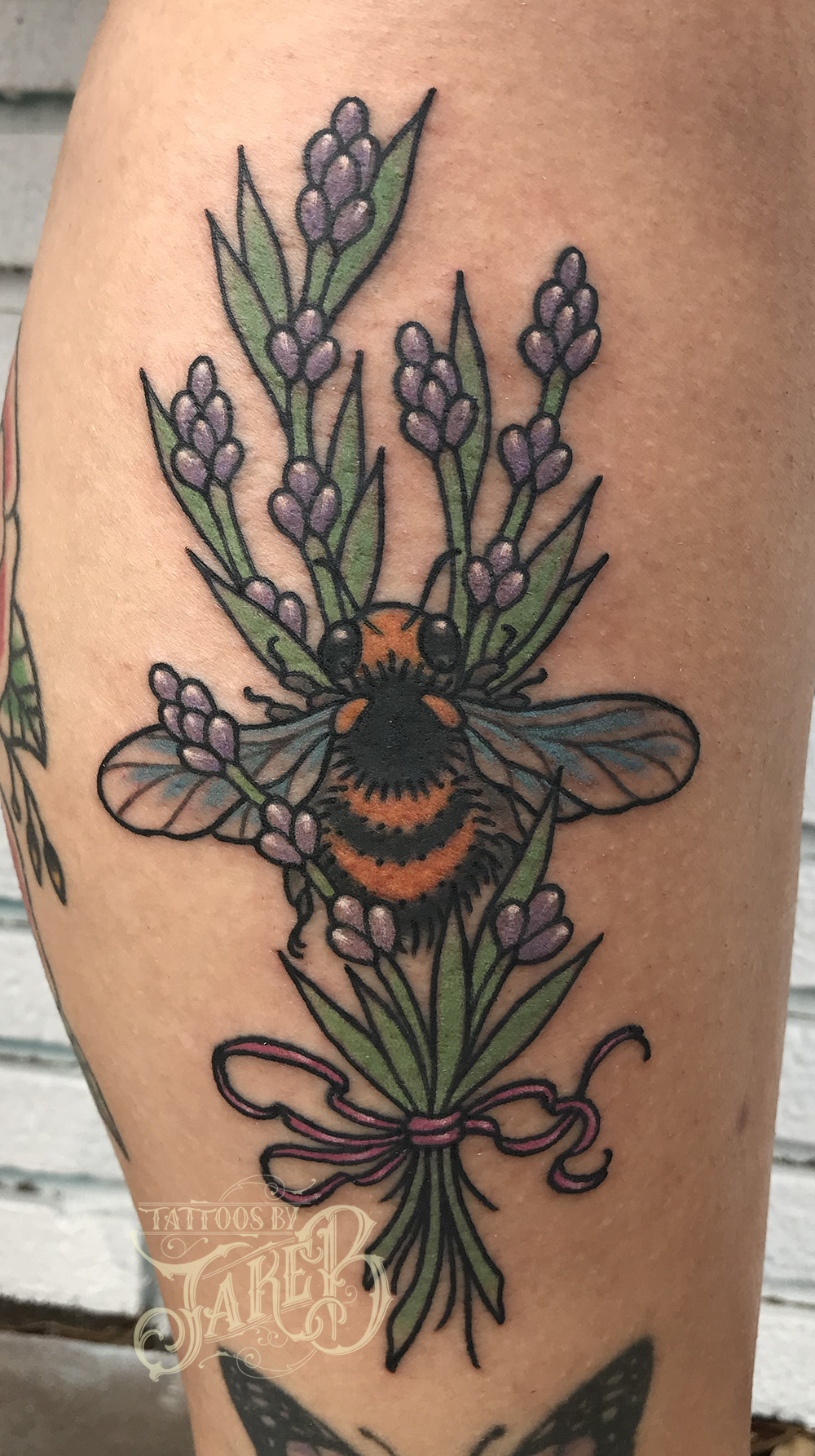 traditional flowers and bee tattoo