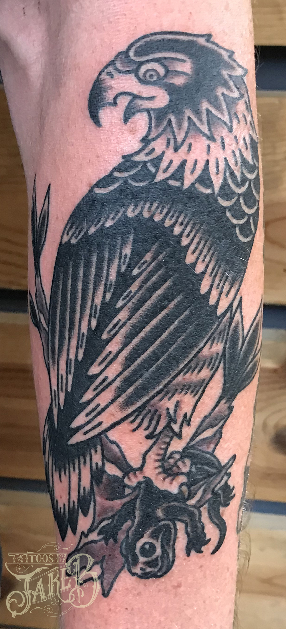 Black & grey falcon tattoo by Jake B